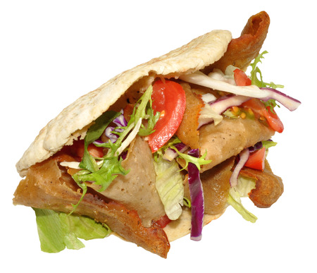 A takeaway doner kebab in a pita bread, isolated on a white background