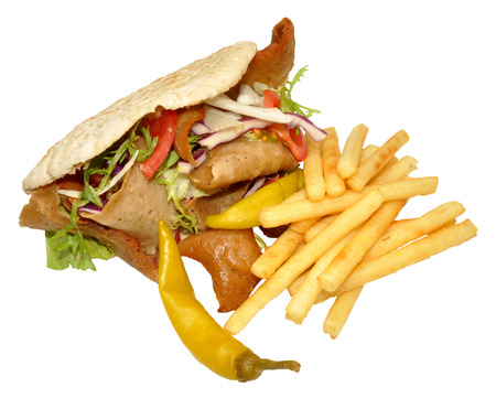 pita: A takeaway doner kebab in a pita bread with fries, isolated Stock Photo