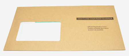A voter registration form in a brown envelope with don�t loose your right to vote printed on it, isolated on a white background  photo