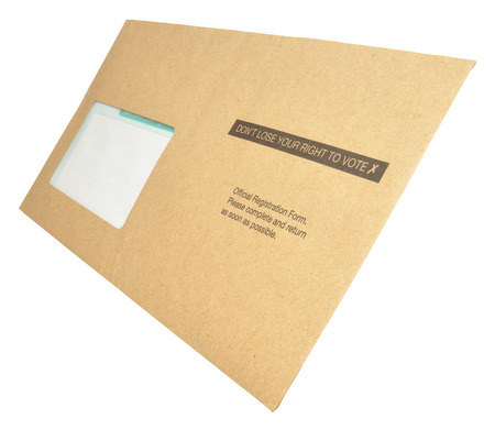 voter registration: A voter registration form in a brown envelope with dont loose your right to vote printed on it, isolated