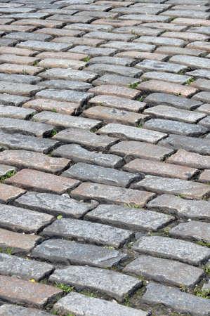A traditional British cobblestone road surface