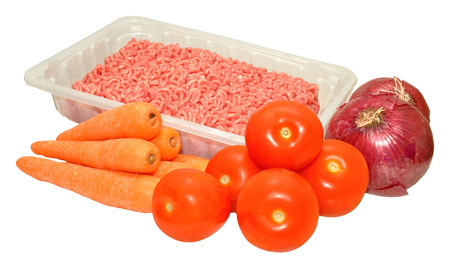 basic food: A selection of basic food groceries including minced beef, carrots, tomatoes and red onions, isolated on a white background