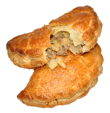 Two traditional Cornish pasties, isolated on a white background