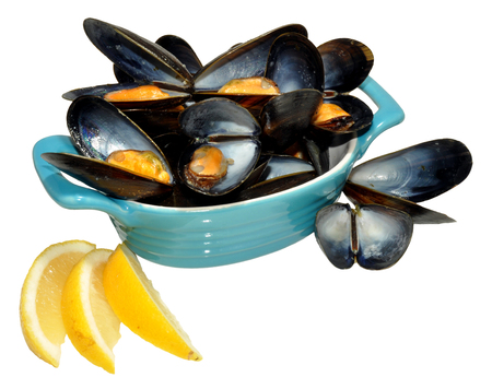 Fresh cooked mussels with lemon slices in a blue dish, isolated on a white background     photo
