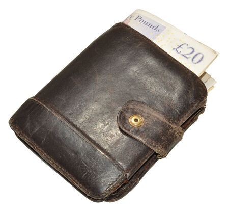 An old worn out leather wallet and English bank notes, isolated on a white background  photo