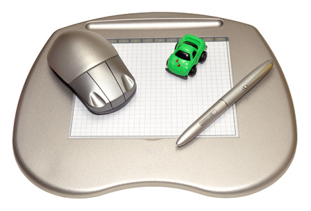 stylus pen: A computer graphics tablet with stylus pen, wireless mouse and colourful toy cars, isolated on a white background