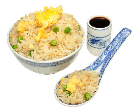 Chinese egg fried rice in a oriental bowl and spoon, isolated on a white photo
