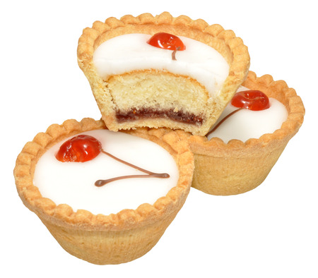 Individual cherry Bakewell tarts, isolated on a white  photo