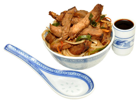 Beef stir fry meal in a traditional Chinese decorated bowl, isolated on a white Stock Photo - 25115037