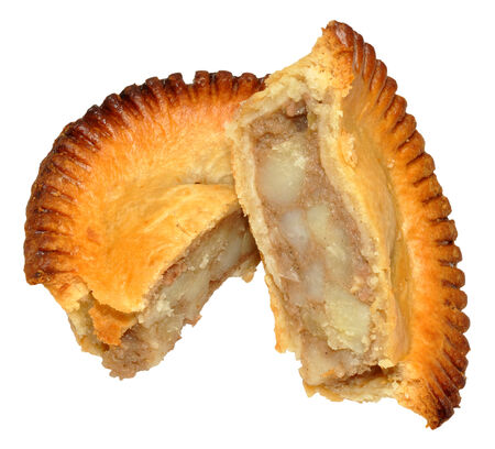 A single potato and meat filled pie cut in half, isolated on a white background  photo