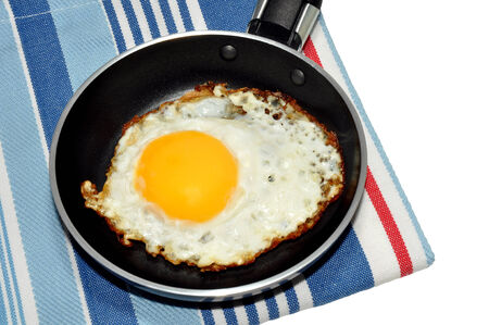 non: Single fried egg in a non stick frying pan, isolated on a white background