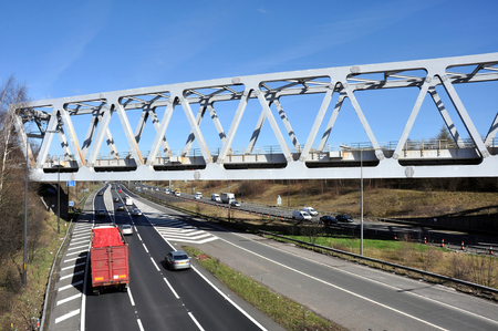 steel girder: A Warren truss steel girder bridge spanning the M60 motorway in Brinnington, Stockport, Greater Manchester, Great Britain  Stock Photo