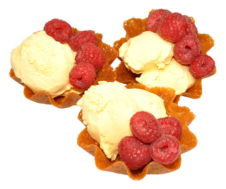 casings: Vanilla ice cream in brandy snap baskets with fresh raspberries, isolated on a white background  Stock Photo