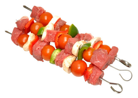 Raw uncooked beef kebabs with vegetables, isolated on a white background  Archivio Fotografico