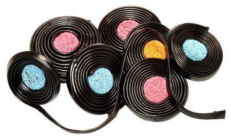 centres: Soft liquorice Catherine wheel candy with aniseed flavour centres, isolated on a white background