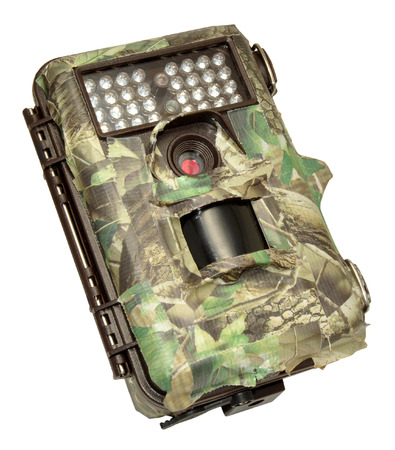 infra red: Infra red wildlife trail camera covered in camouflage tape, isolated on a white background  Stock Photo