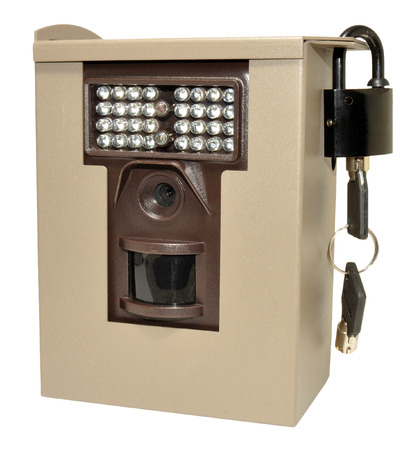 Infra red wildlife trail camera in a locked metal security case, isolated on a white background  photo