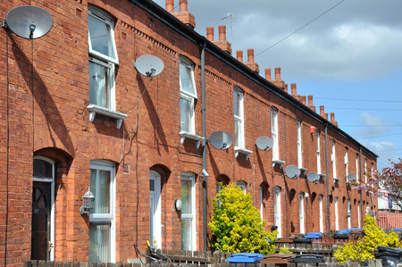 Row of traditional northern English red brick terraced houses