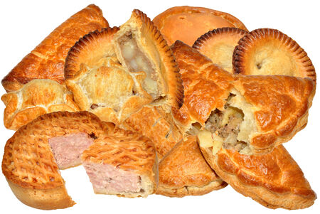 Assortment of meat pies, pasties and sausage rolls, isolated on a white background  photo