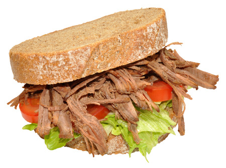 Shredded beef sandwich on sliced rye bread, isolated on a white background Archivio Fotografico
