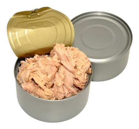 Opened tin of tuna fish meat, isolated on a white background  photo