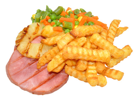 Gammon steak and crinkle cut chips, with mixed vegetables and pineapple ring, isolated on a white background  photo