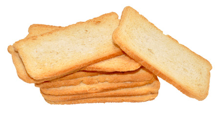 melba: Pila de crujientes tostadas Melba, aislado en un fondo blanco Foto de archivo