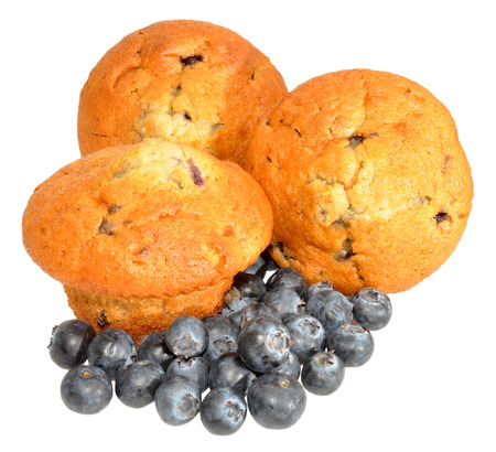 Baked blueberry muffins with fresh blueberries, isolated on a white background  photo