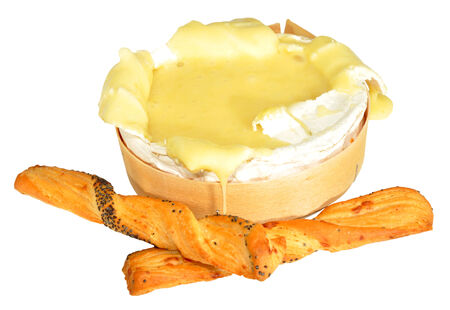 runny: Baked runny French camembert cheese and bread sticks, isolated on a white background