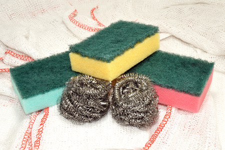 Group of colourful sponge and metal cleaning scourers with green scrubbing surfaces   Banco de Imagens
