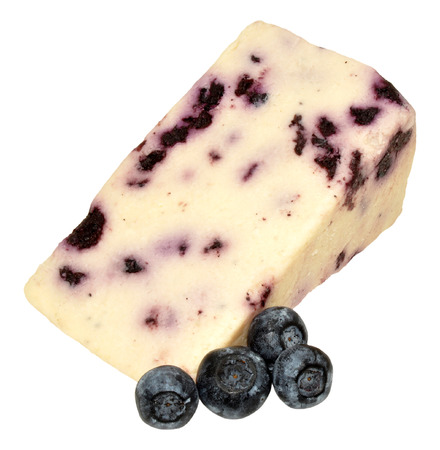 Wedge of blueberry white Stilton cheese with blueberries, isolated on a white background