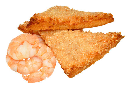 Crispy Chinese prawn toast with sesame seed topping, isolated on a white background