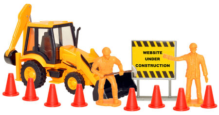 tractor warning: Toy construction set with website under construction sign, isolated on a white background.