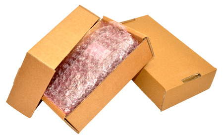 Plain cardboard box with contents, isolated on a white background.