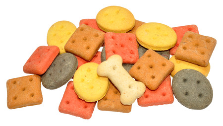 Pile of dog biscuit shapes, isolated on a white background photo
