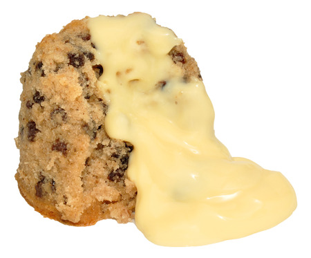 Spotted Dick Sponge Pudding With Custard, isolated on a white background.