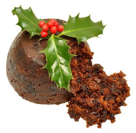 christmas pudding: Traditional Christmas pudding with holly leaves and red berries, isolated on a white background.