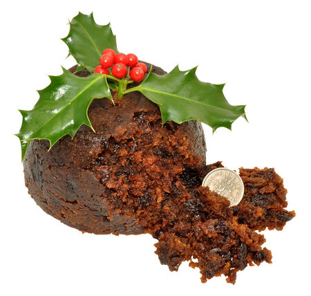 Traditional Christmas pudding with holly leaves, red berries and silver coin, isolated on a white background. photo