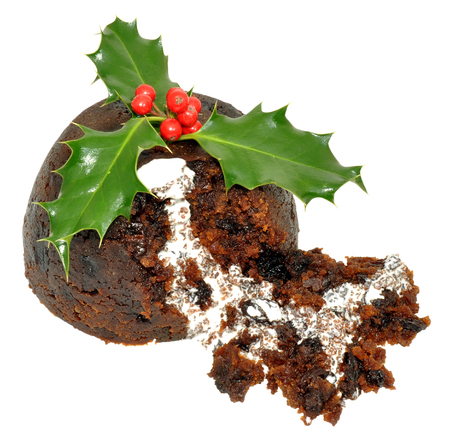 Traditional Christmas pudding with holly leaves, red berries and cream, isolated on a white background. photo