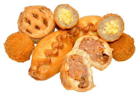 party with food: Savoury party food snacks including mini scotch eggs, pork pies and Cornish pasties isolated on a white background.