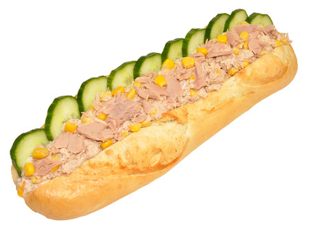 Tuna and sweet corn sandwich with cucumber in a crusty baguette isolated on a white background. photo