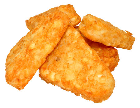 browns: Pile of cooked potato hash browns isolated on a white background. Stock Photo
