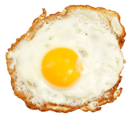 Single crispy fried egg with yellow yolk isolated on a white background. photo