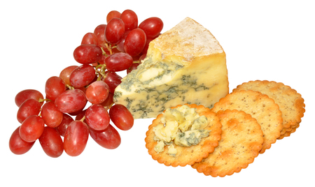 Bunch of red grapes and wedge of blue stilton cheese with cheese biscuits isolated on a white background photo