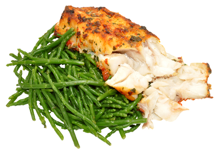 Grilled fish and samphire a coastal plant with vibrant green stalks and a crisp salty taste isolated on a white background photo