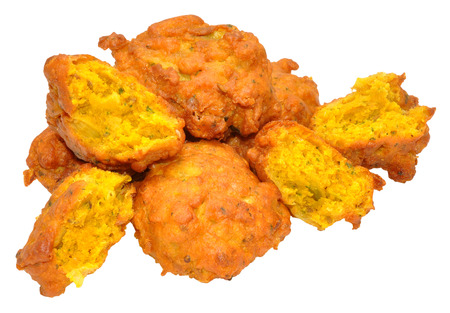 onion bhaji: Traditional Indian spicy fried onion bhajis isolated on a white background