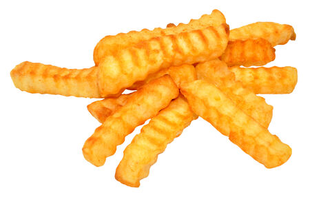 crinkle: Crispy crinkle cut fried potato chips, isolated on a white background Stock Photo