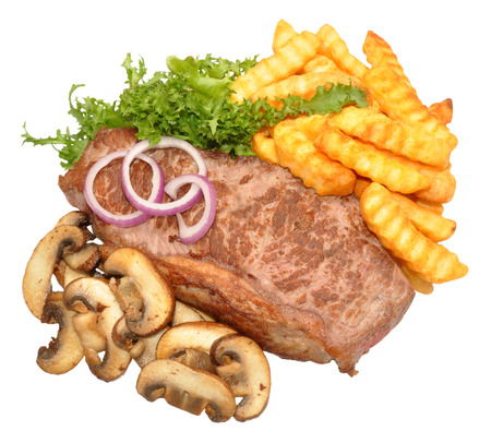 Fried sirloin steak and mushrooms with chips and green lettuce leaves isolated on a white background photo
