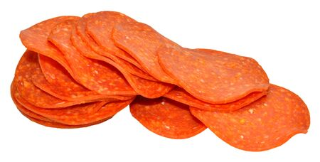 Group of sliced spicy Italian pepperoni sausage isolated on a white background