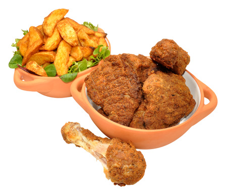 portions: Cooked southern fried chicken portions and potato wedges in bowls isolated on a white background Stock Photo